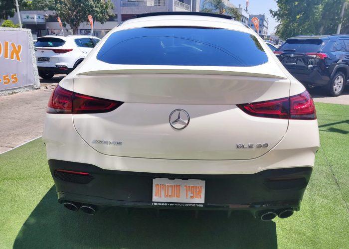צילום אחורי של הרכב מרצדס GLE-53 קופה AMG לבן פנינה 2021 רכבי יוקרה 0 קמ